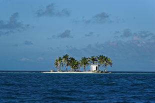 """Little """"Toilet island"""" in the middle of Caribbean sea (Belize, Placencia)."""
