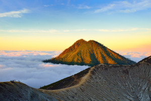 Mountain above the clouds from the rim of the Kawah Ijen volcano