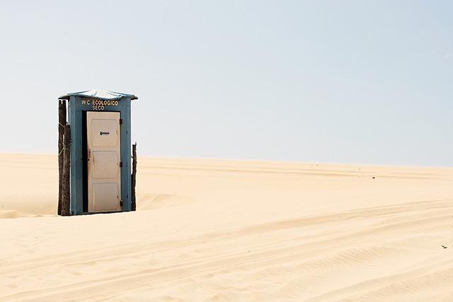 An isolated toilet in the Lencois Maranhensis sand dunes of Brazil.