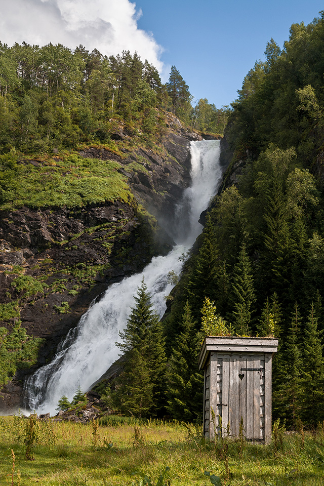 A toilet next to Huldefossen waterfall, Norway.