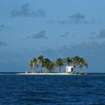 "Little ""Toilet island"" in the middle of Caribbean sea (Belize, Placencia)."