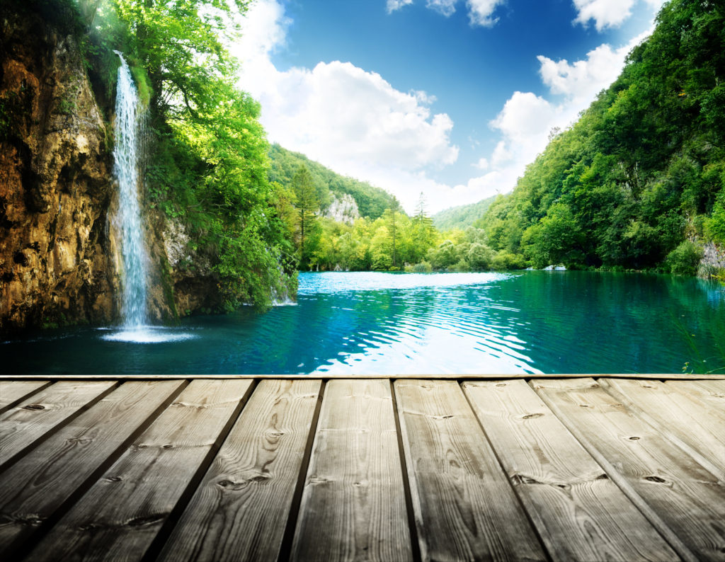 waterfall in deep forest of croatia and wood pier